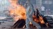 உ.பி.யில் கொரோனா கொடுமை.. வயல்களில் எரிக்கப்படும் சடலங்கள், ஊரக வேலை திட்டத்திற்கு வராத தொழிலாளர்கள்