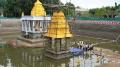 ஆனந்தசரஸ் குளத்தில் நீராழி மண்டபத்தில் ஆனந்த சயனம் கொண்ட அத்திவரதர்  - கொட்டிய மழை