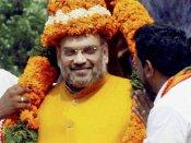 உ.பி. தேர்தல் ஜூரம்... கும்பமேளாவில் தலித் சாதுக்களுடன் புனித நீராடிய அமித்ஷா