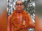 காவி ஷெர்வானியில் அம்பேத்கர் சிலை... உ.பி அரசின் விஷமத்தால் மீண்டும் சர்ச்சை!