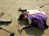 A Mother cries for her child's death in Tsunami attack