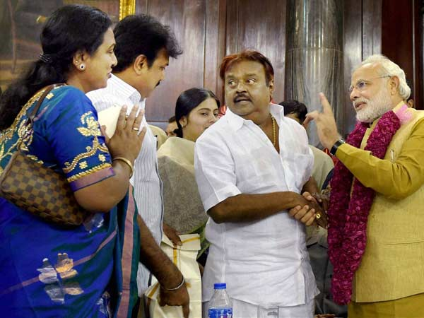 Vijayakanth greet Modi with family