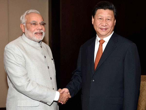 Xi Jinpin says China, India partners not rivals