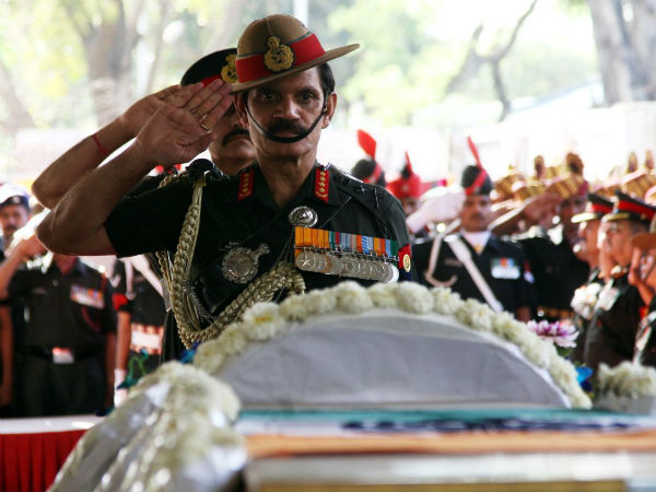 Army rescuers find mom's photo next to martyr's mortal remains