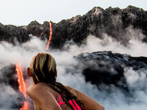 This lady swims near boling Lava of a Volcano