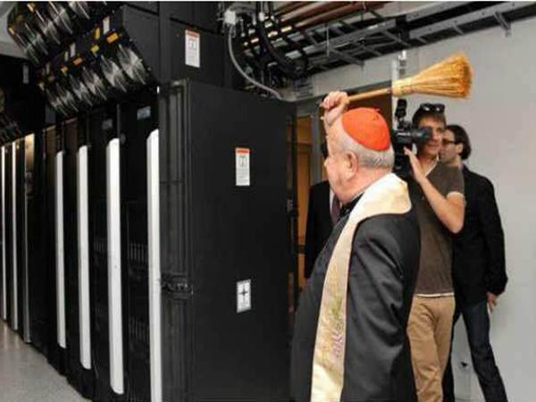 top priest blessing government computers with holy water