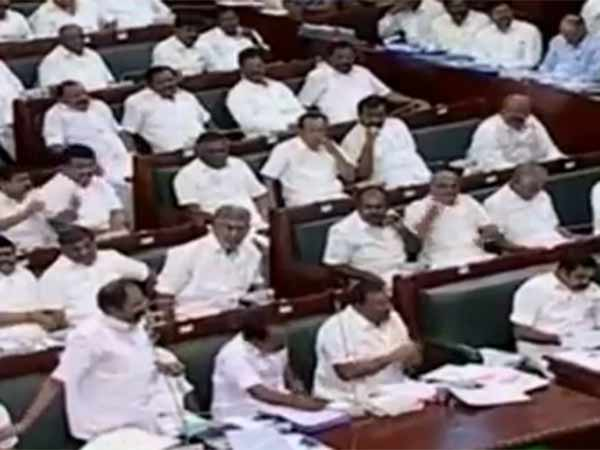 DMK MLAs protest with banners which quotes MLA for sale