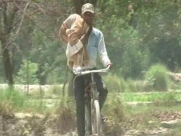 Denied ambulance, UP man carrying dead niece on cycles