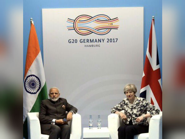 PM meets Theresa May, seeks UK help for economic offenders