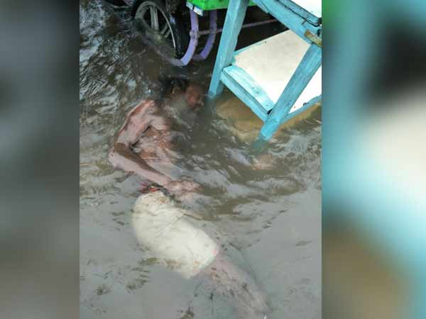 A old beggar man died after draining in Marina flood