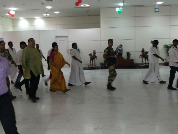 DMK workers arranged a small stage at the airport for Kanimozhi and Raja