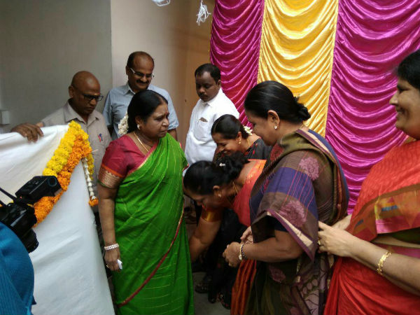 DMK Women's wing members touch Rajathi Ammal feet