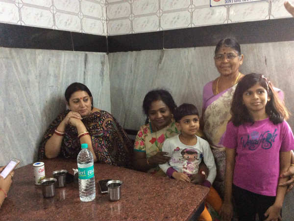 Tamilisai having lunch with Minister Smriti Irani at Saravana Bhavan