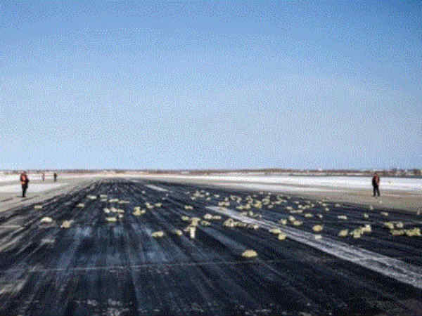 A plane's door flew open during takeoff, raining gold and silver over 16 miles of Siberia