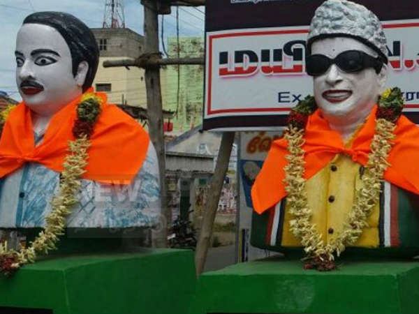 Saffron dress for Periyar, Anna and MGR statue in Namakkal.