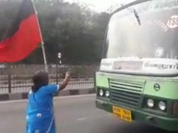 Old lady stop the bus on the National Highway in Ambur