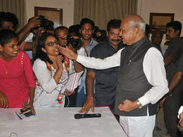 Governor Banwarilal Purohit pat on the cheek of the lady reporter