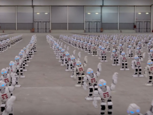 over 1300 robots dance in sync
