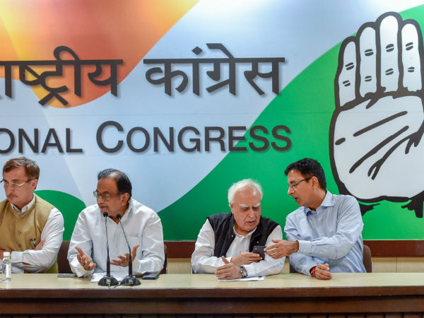 congress condemns governor inviting bjp