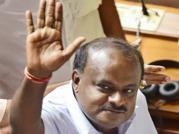 CM Kumaraswamy gives education portfolio to class 8 pass minister his reaction to this question
