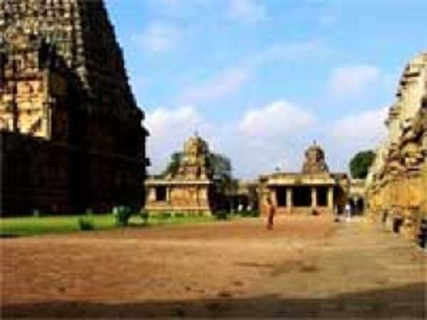 Devotees worship the old stones in Tanjore Big Temple