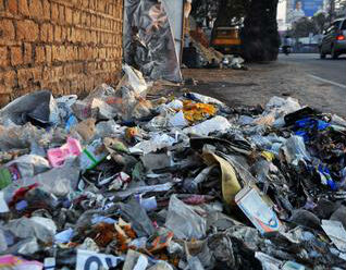 Municipal workers dumped the trash on the road in Namakkal