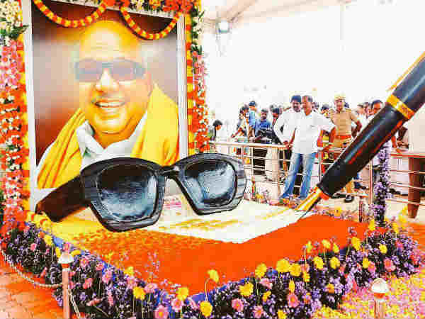 Black specs and Pen are kept in Karunanidhis memorial