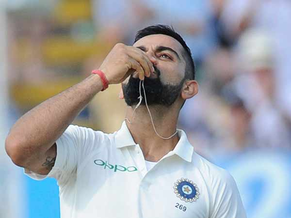 Kohli kisses marriage ring after century
