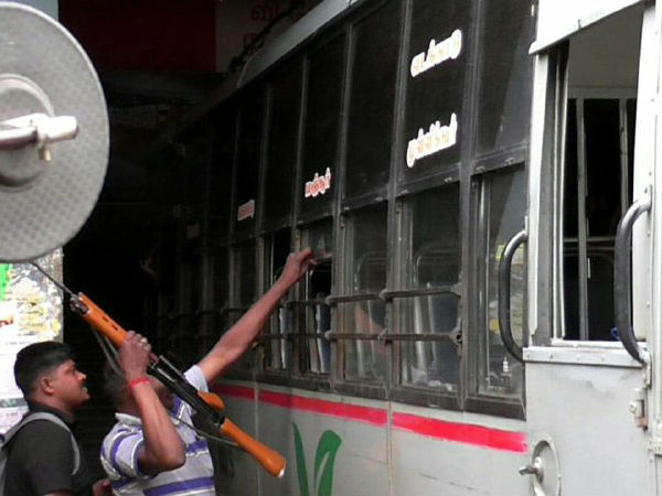 Policeman place his gun in bus seat to occupy place in Coonoor
