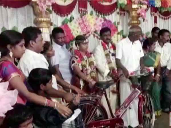 Petrol and Diesel price hike: Brides family gives cycle as dowry