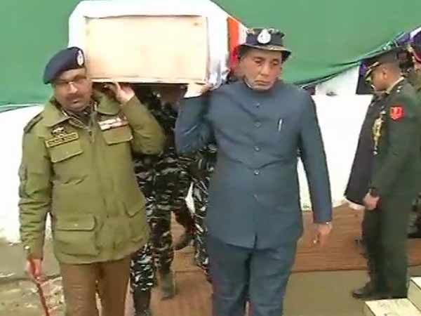 Rajnath Singh lend a shoulder to mortal remains of a CRPF soldier