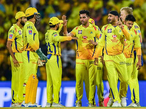 Chennai super kings players images Pasted in Chennai local train