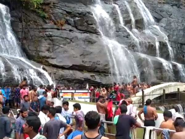Tourists throng Courtallam for take a bath in falls
