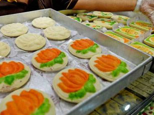 Laddoos cakes and lotus shaped barfis by BJP, Congress accuses