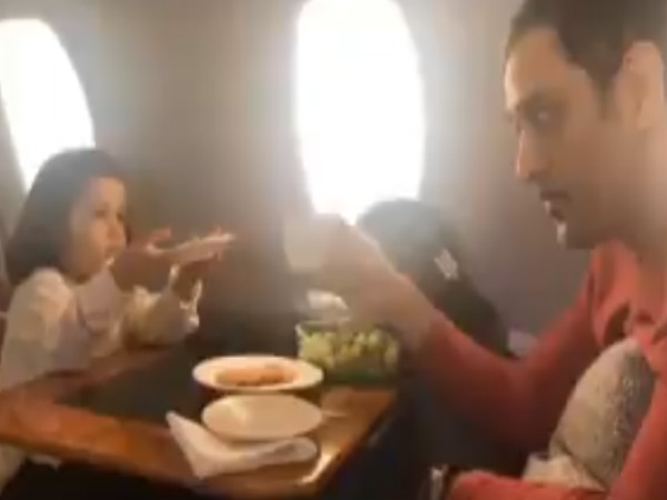 MS Dhoni plays with his daughter Ziva on flight