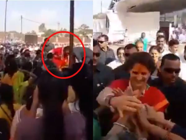 Priyanka Gandhis jumps over the barricade to see women in a rally in MP