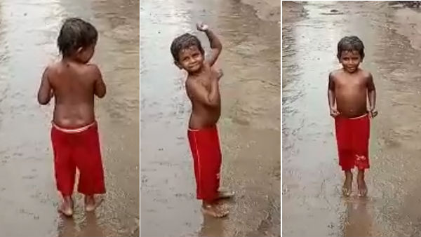 Viral Video about A Boy enjoying the rain in Street