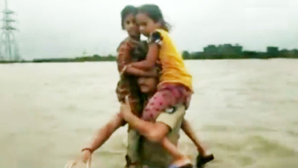 Gujarat Police rescues 2 children on his shoulders for 1.5 km in flood water