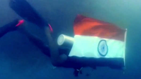 Swimming experts from Pondicherry swim with National Flag