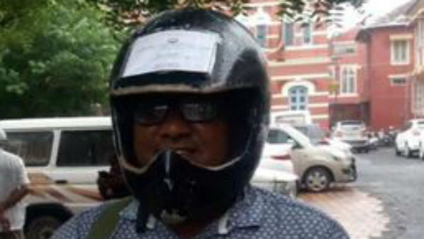 man sticks vehicle documents on helmet to avoid fines