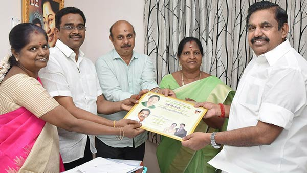 admk mla manonmani sivakumar avoid ops image in her family marriage invitation