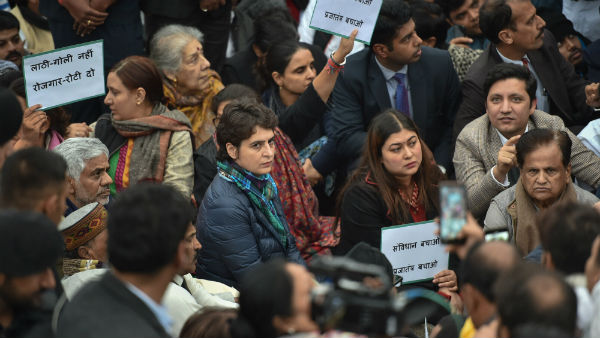 Priyanka Gandhi sit on a symbolic protest over police action during students