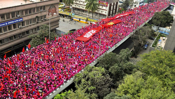 Accredited Social Health Activists (ASHAs) stage protest rally in Bengaluru with Pink saree