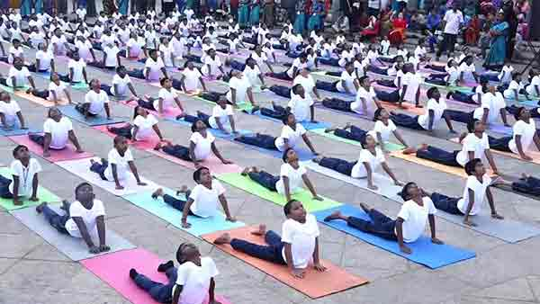 In Puducherry Beach Road School students perform various yoga poses