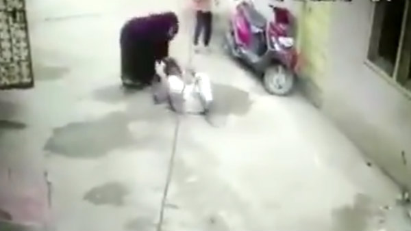 A woman being thrashed by her daughter-in-law and her mother in Hyderabad