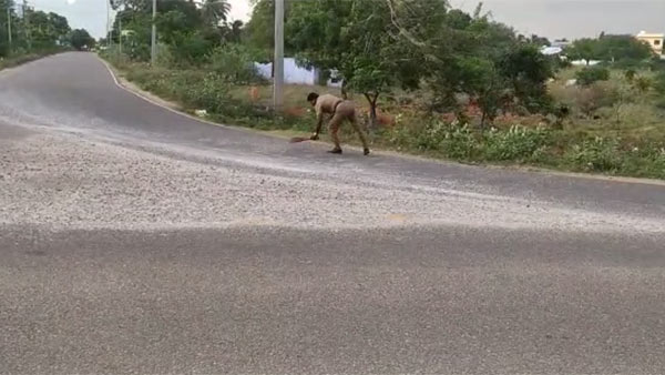 head Constable Jagadeesh sweeping Gravel scattered on road near Panakudi in Nellai