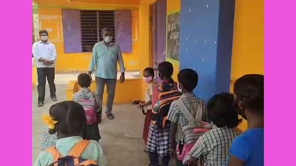 Primary School Students entering a school near Salem