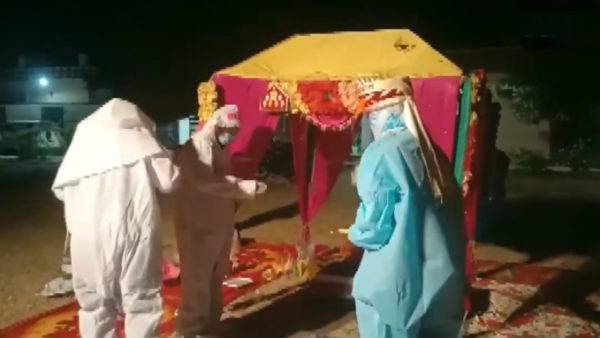 Viral video of Rajasthan couple getting married in PPE kits at Covid Centre