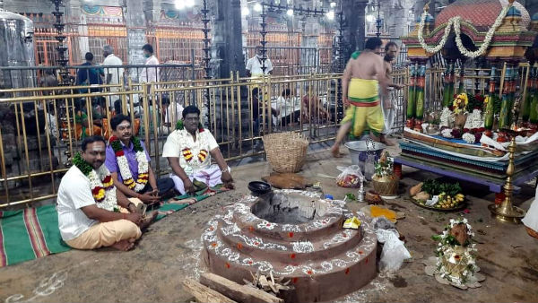 Thiruvannamalai: Praying Pooja at the top of the hill sprinkling of holy water
