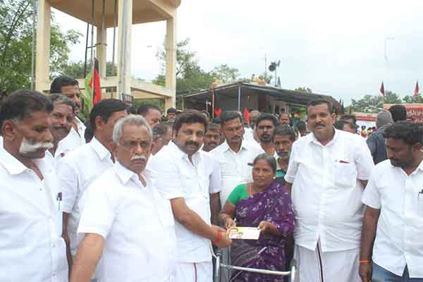 Dmk District secretary financial assistance to a woman suffering from cancer